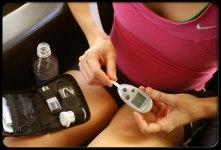 Athlete checking blood glucose